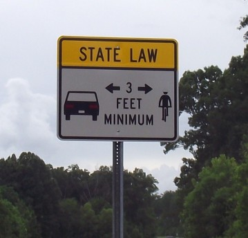 Sign Showing Cars Must Be 3 Feet Away From Bicycle Riders