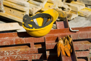 hard hat and gloves at a construction site