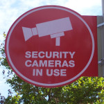 Store sign saying security cameras in use